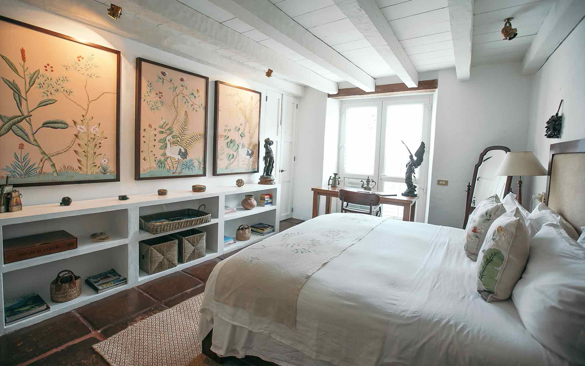Heron room across the bed with view of the light pink batik panels