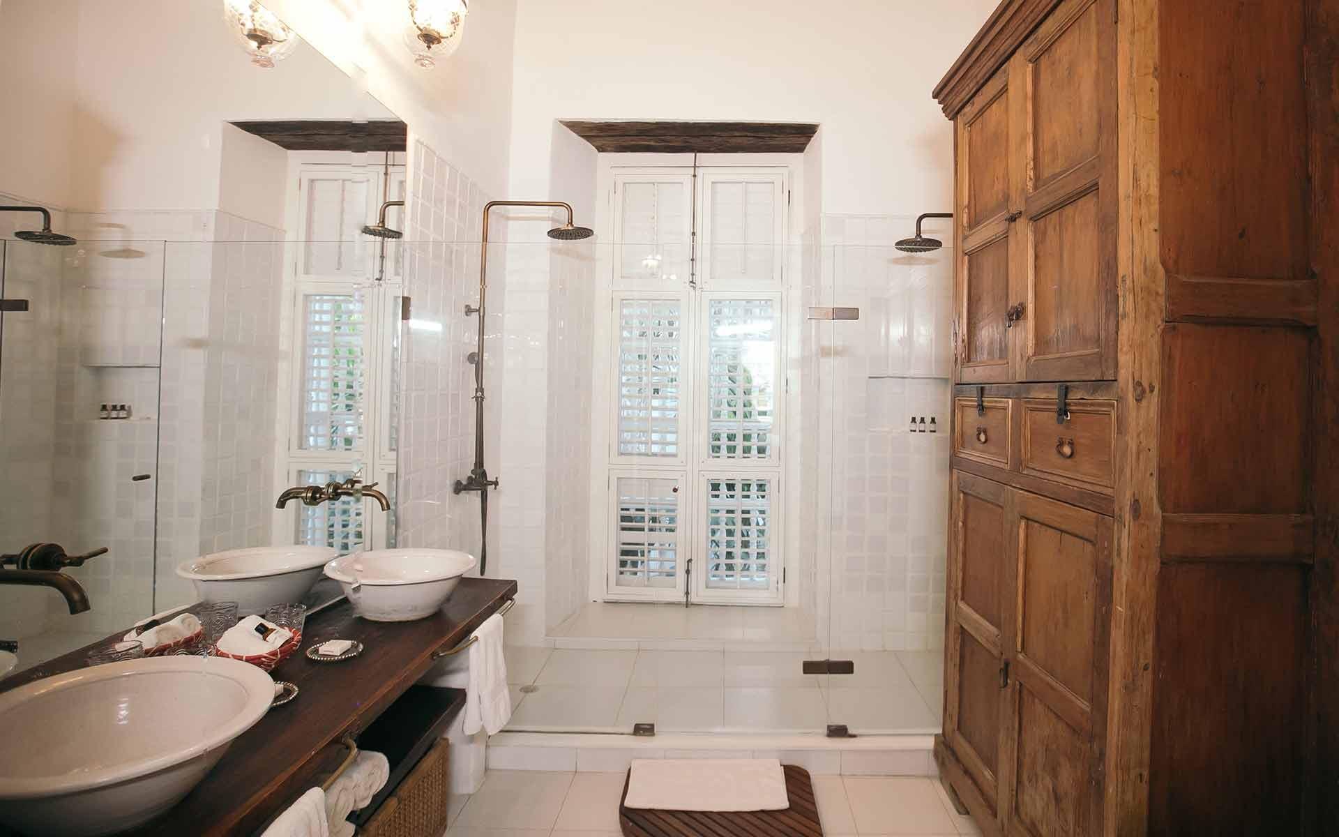 Heron bathroom at Amarla Boutique Hotel featuring twin basins and walk in shower