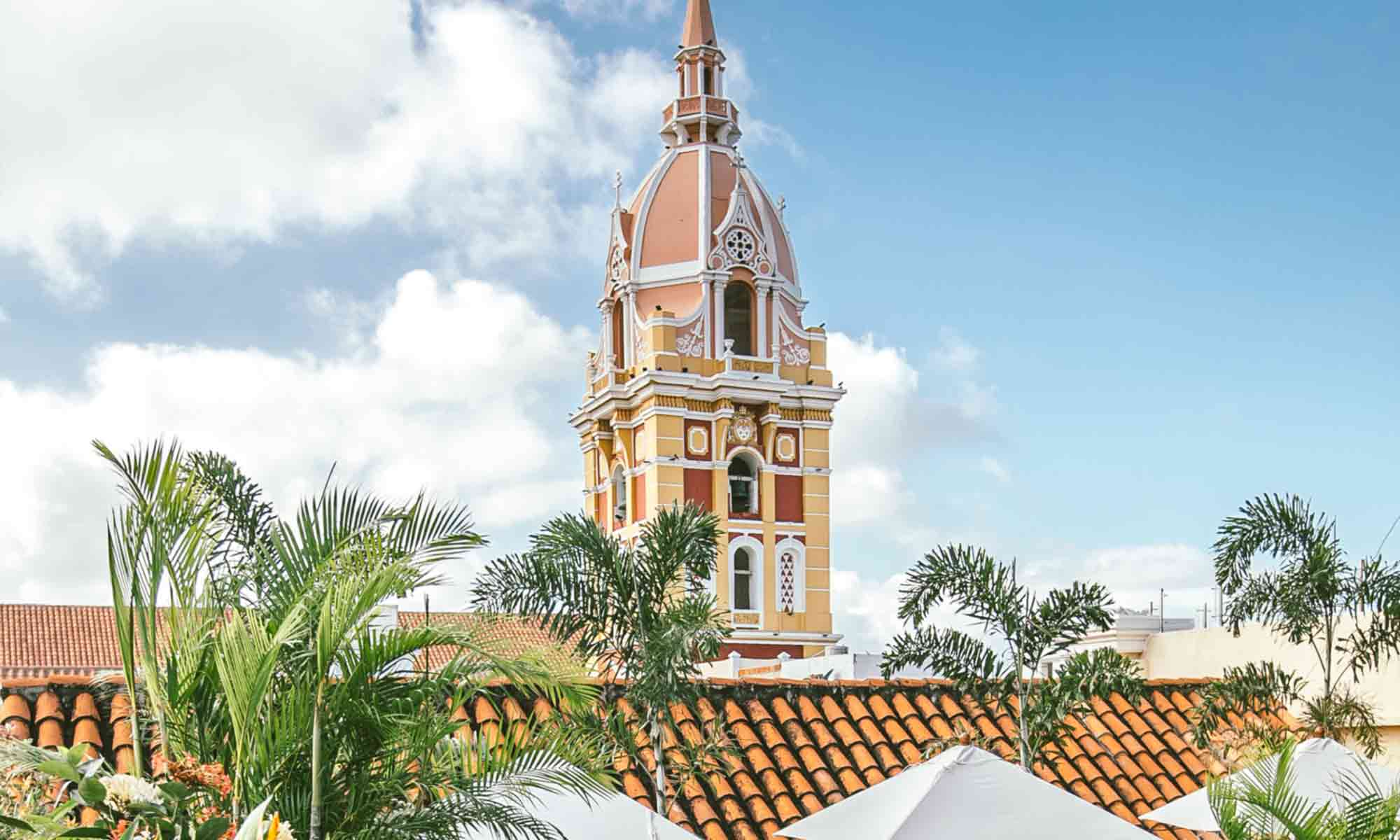 Famous view of the cathedral spire from the Amarla rooftop in Cartagena walled city