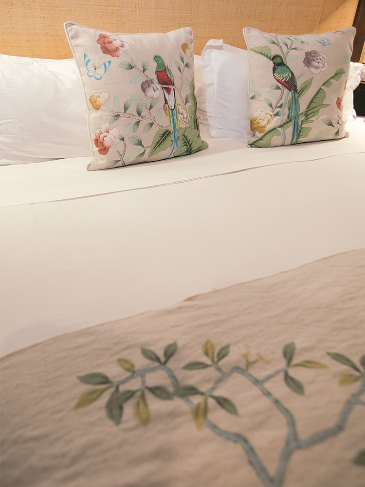 Close up of bed and Quetzal cushions at Amarla