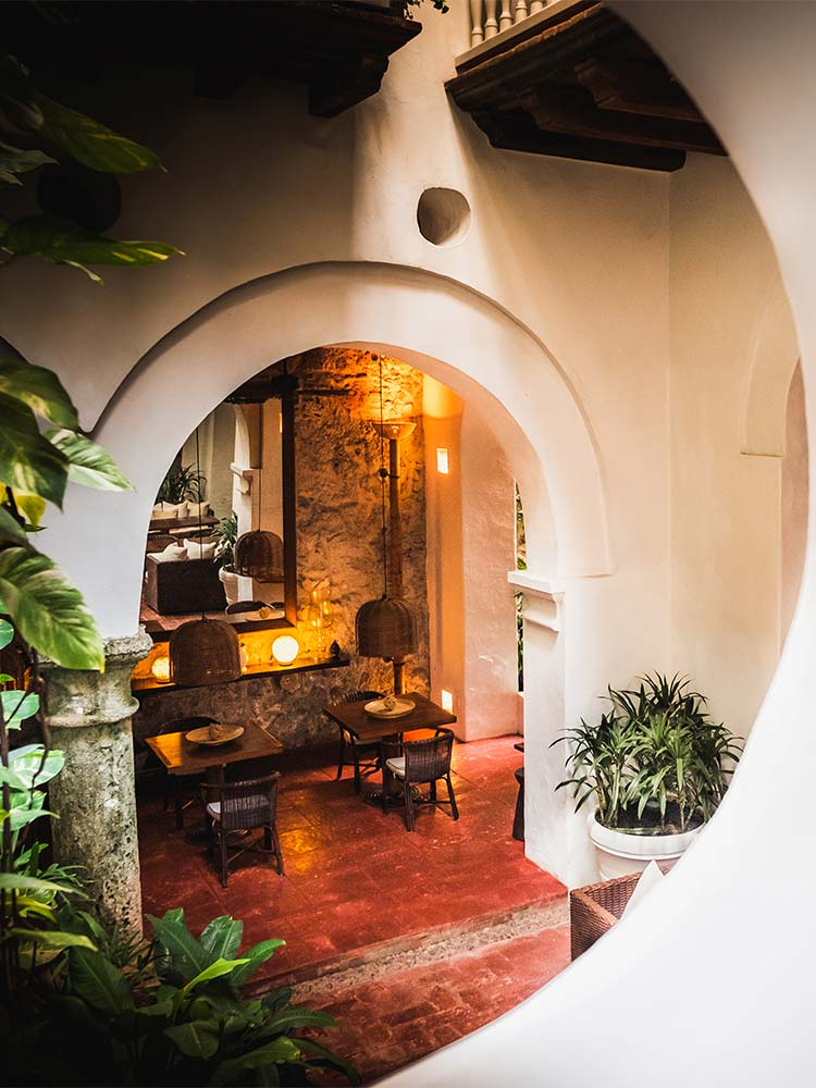 View from the stairs toward the dining area in Amarla Boutique hotel Colombia