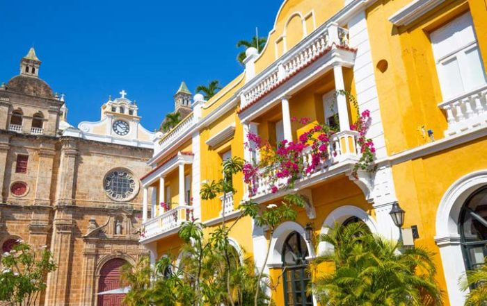 Beautiful yellow building in old town streets near the Amarla one of the best hotels in Cartagena