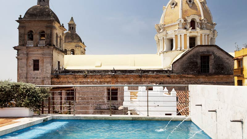 Hotel rooftop pool with church view in Cartagena, the best experience.