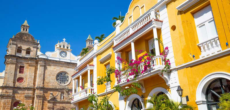 See the colorful buildings while on a stroll around the old town as seen in the guide to the best hotels in Cartagena